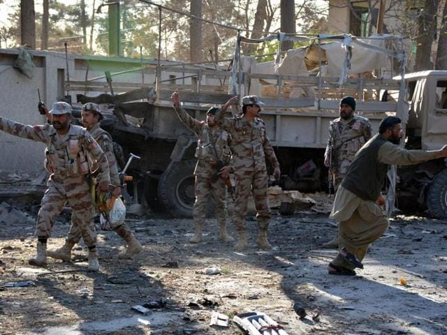 Pakistani paramilitary soldiers cordon off the site of a bomb explosion Quetta.