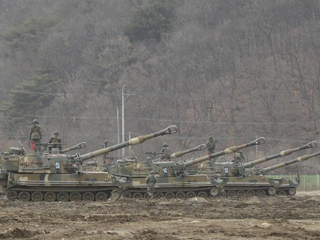 South Korean army soldiers stand on their K-55 self-propelled howitzers during an annual exercise in Paju, near the border with North Korea.