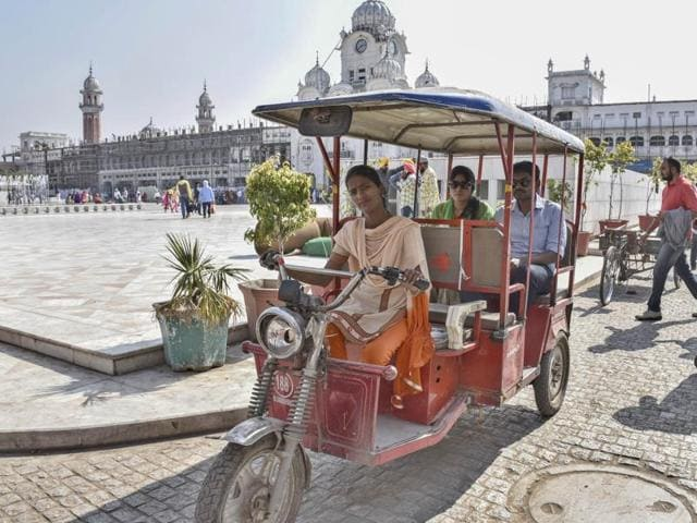 Sonia, the lone woman driver of battery-operated rickshaw, ferrying pilgrims to the Golden Temple in Amritsar.