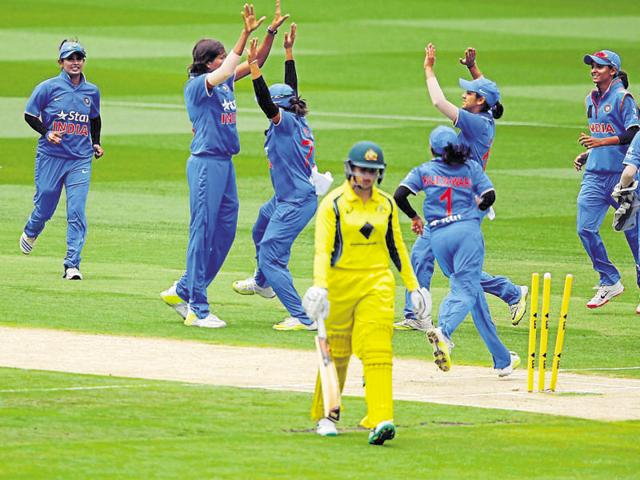 Jhulan Goswami celebrates with her team after Grace Harris of Australia is bowled out.
