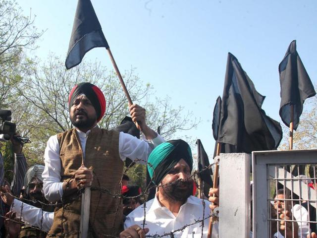 Congress MLA's protesting outside the Punjab Vidhan Sabha during the budget session in Chandigarh on Tuesday.