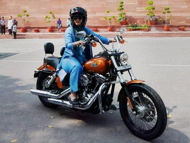 Congress MP Ranjeet Ranjan rides a Harley Davidson at Parliament House in New Delhi on International Women's Day on Tuesday.
