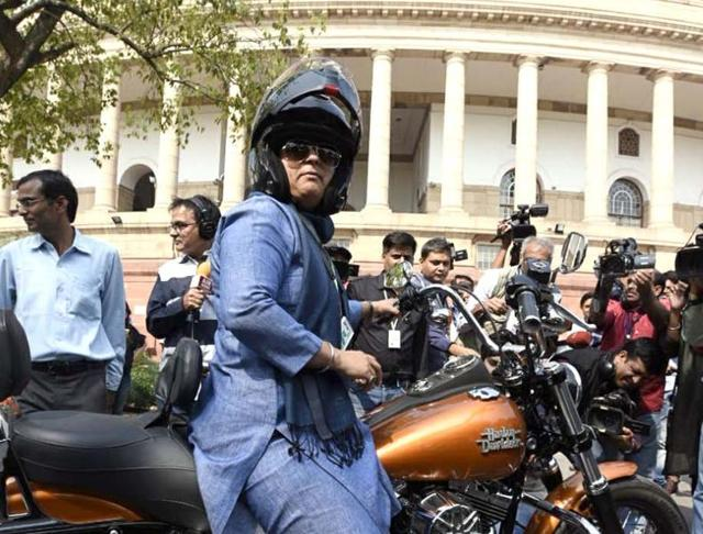 Ranjeet Ranjan, Congress party MP from Supaul, Bihar and wife of Pappu Yadav arrives at Parliament House on her Harley Davidson bike on the occasion of International Women's Day in New Delhi on Tuesday.