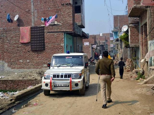 Policemen at Tigri village of Greater Noida in UP after a 16-year-old girl  was found burnt on Monday, March 07, 2016. Police have arrested a young man in this connection.