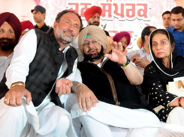Punjab Congress chief Captain Amarinder Singh flanked by his wife and Patiala MLA Preneet Kaur and former MLA Madan Lal Jalalpur at a rally in Ghanaur village near Patiala on Monday.
