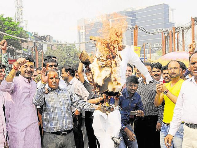 Jewellers burnt an effigy and took out a procession to protest against the increase in excise duty on gold.