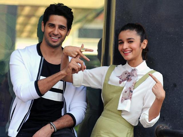 Sidharth Malhotra and Alia Bhatt pose during a promotional event for their upcoming film, Kapoor and Sons, in Mumbai.