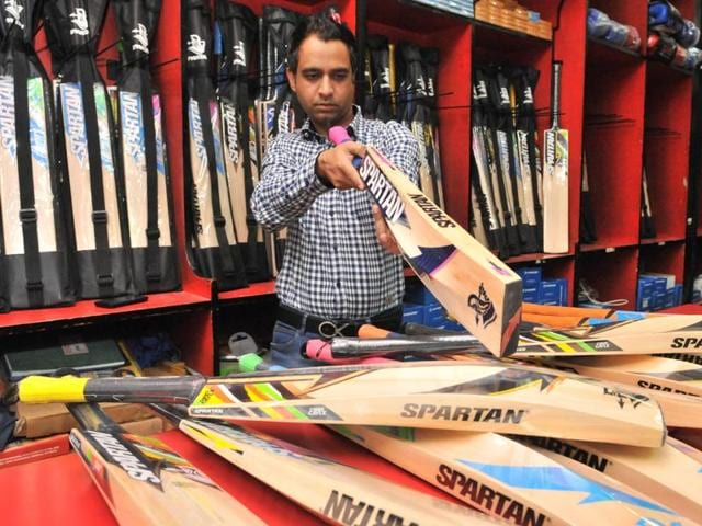 Director of Spartan sports goods manufacturing company, Amit Sharma, inspecting a cricket bat in Jalandhar on Monday.