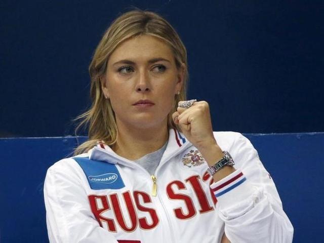 Maria Sharapova reacts as she watches compatriot Ekaterina Makarova play against Kiki Bertens.
