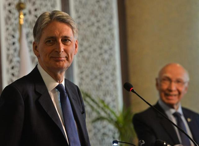 Pakistan prime minister's advisor on foreign affairs Sartaj Aziz (right) and British foreign secretary Philip Hammond arrive for a joint press conference in Islamabad on Tuesday.