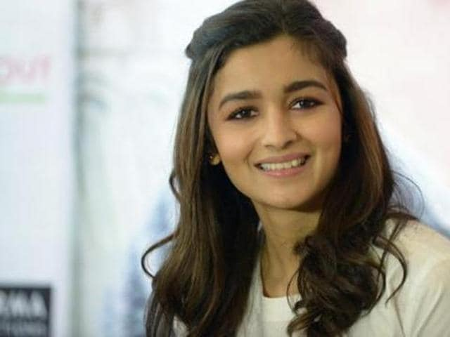 Alia Bhatt smiles during a media interaction in Ahmedabad on October 20, 2015. (AFP)