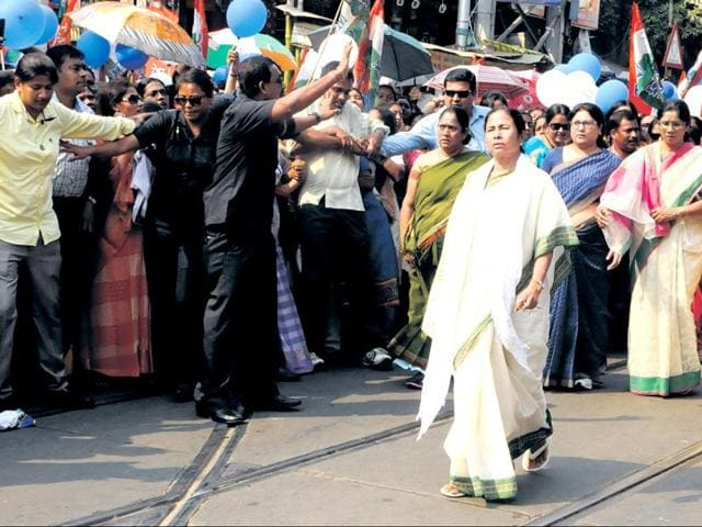 Mamata Banerjee leads her leaders in a march through Kolkata on Tuesday.