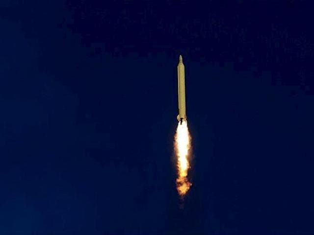 Ballistic missiles are launched and tested in an undisclosed location in Iran in this handout photo released by Farsnews.