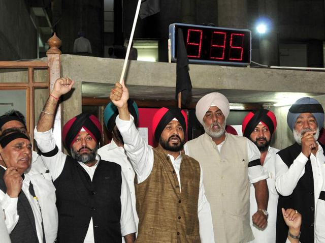 Congress legislators protesting outside the assembly in Chandigarh on Tuesday.
