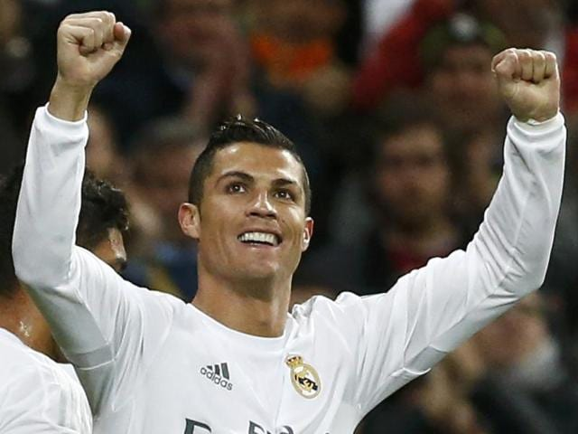 Real Madrid's Cristiano Ronaldo was the scourge of AS Roma again as he inspired the hosts to a 2-0 win and a place in the Champions League quarter-finals.