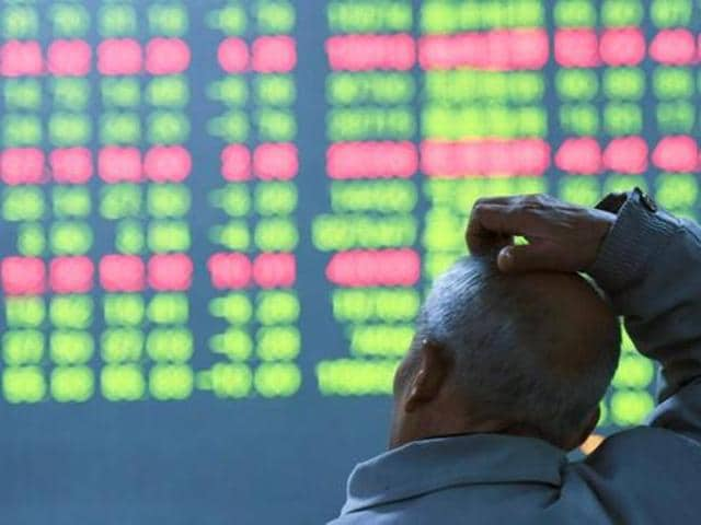 An investor looks at an electronic screen showing stock information at brokerage house in China. A weak trade data from China shows that the Asian giant is still not out of the woods.