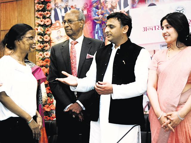 Chief minister Akhilesh Yadav, along with wife Dimple, felicitates acid attack survivors in the event on Tuesday in Lucknow.