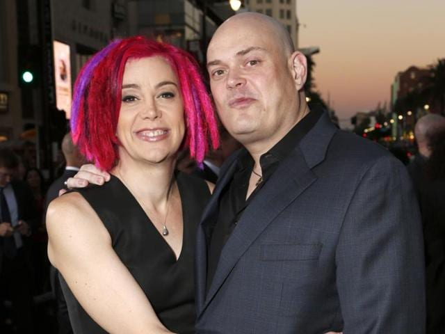 Andy Wachowski and sibling Lana Wachowski, the screenwriters, producers and directors of the film Cloud Atlas, pose as they arrive for the film's premiere.