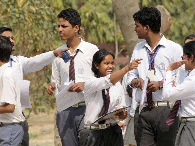 Students coming out of  examination centre after appearing in a Central Board of Secondary Education paper.