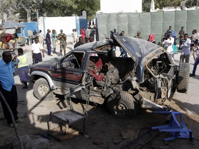 The wreckage of the car used for suicide bombing sits outside the police academy in Mogadishu, Somalia.