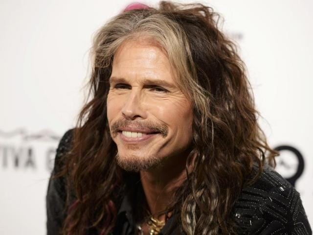 Steven Tyler and his assistant Aimee Ann Preston showed off their affection for each other at Sir Elton John AIDS Foundation's Oscar Viewing Party.