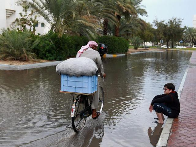 Municipal workers pump water from a flooded street following in Abu Dhabi.