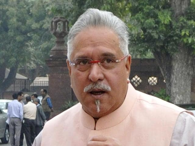 Vijay Mallya (R) in New Delhi on the opening day of the winter session of Parliament