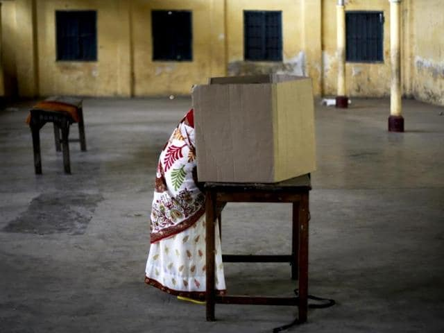 A woman casts her vote during the first phase of elections in Dibrugarh. Poll pundits say the BJP and the AGP have taken more of their disadvantages along in their bid to win mandate 2016 together.