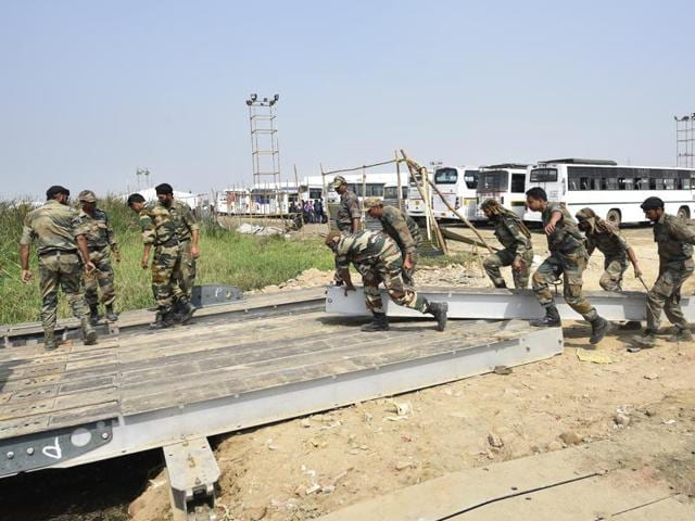 Indian Army soldiers construct a pontoon bridge across the Yamuna.