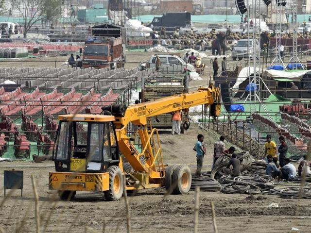 The NGT on Wednesday slapped an initial fine of Rs.5 crore on spiritual guru Sri Sri Ravi Shankar's Art of Living, but declined to stay the holding of the World Culture Festival on the fragile Yamuna flood plain.