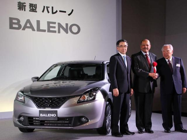 Kenichi Ayukawa, the MD and CEO of SMC, Indian ambassador to Japan Sujan R Chinoy and President of SMC, Osamu Suzuki at the launch of 'Made in India' Baleno in Japan.