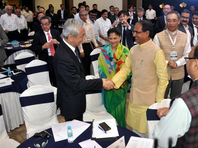 Chief minister Shivraj Singh Chouhan greets Japanese ambassador to India, Kenji Hiramatsu, at the investment promotion seminar for Japanese industrial township, in Indore on Wednesday.