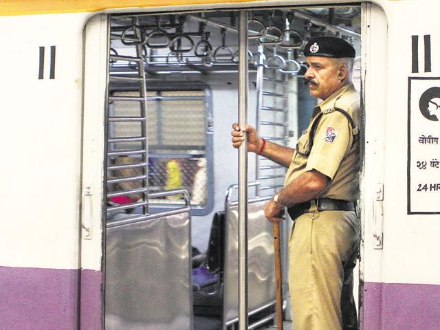 A police constable stands guard inside a women's coach.
