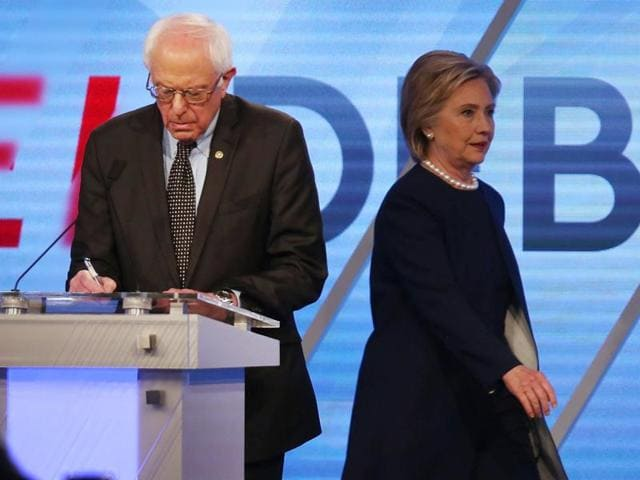 Democratic presidential candidates Bernie Sanders  and Hillary Clinton are seen on stage during the Democratic Presidential Primary Debate at the Miami Dade College's Kendall Campus in Miami, Florida.