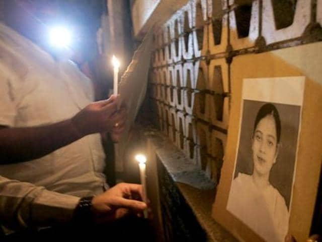 Demonstrators hold a candlelight vigil for Ishrat Jahan, who was killed in an encounter on June 15, 2004.