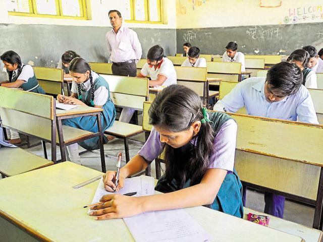 Students taking MP board exam at Govt. Naveen girls higher secondary school in Bhopal.