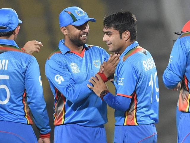 Afghanistan bowler Rashid Khan celebrates with team mates after taking wicket of Hong Kong's Jamie Atkinson.