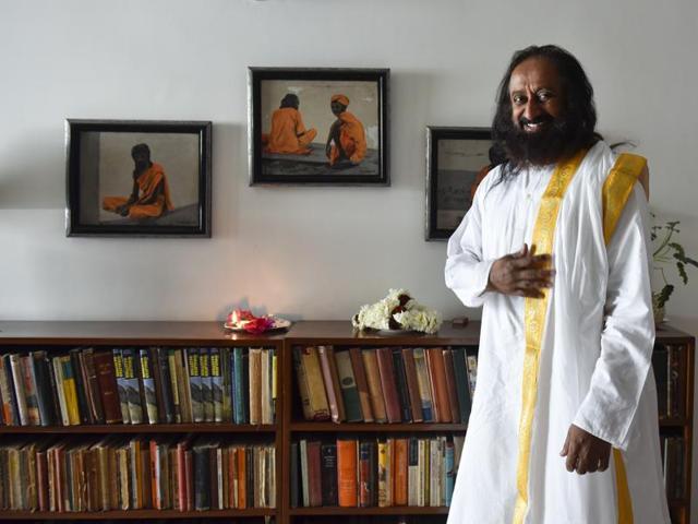 Spiritual guru Sri Sri Ravishankar  waves  to followers on March 1.