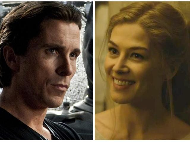 Christian Bale as Bruce Wayne and Rosamund Pike as Amy Dunne from Gone Girl.