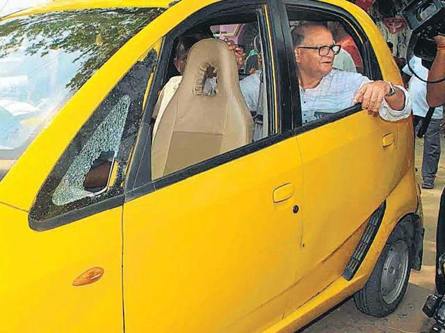CPM nominee from Singur Rabin Deb rides a Nano during campaigning on Thursday.