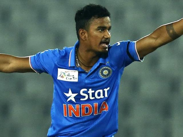India's Pawan Negi unsuccessfully makes a leg before wicket appeal during the Asia Cup Twenty20 international cricket match against UAE.