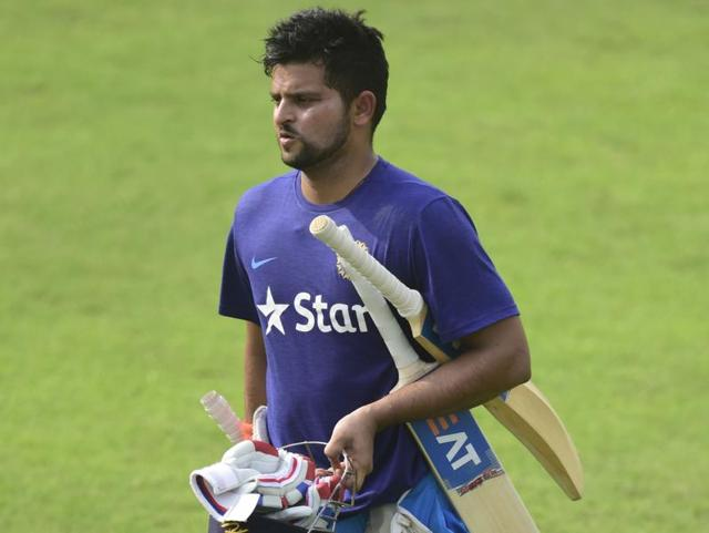 Indian cricketer Suresh Raina walks over the field during a training session at the Sher-e-Bangla.
