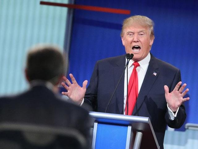 Republican presidential candidate Donald Trump reacts as presidential candidate SenatorTed Cruz rebukes a comment made by him during the Republican debate at the University of Miami on Thursday.(AP)