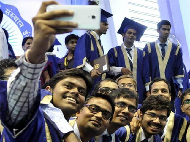IIT-Indore students take selfies after they are conferred degrees at the 3rd convocation of the institute at their Simrol campus.