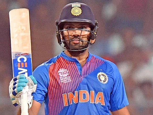 India's Rohit Sharma celebrates his fifty during a practice game against West Indies at Eden Gardens.