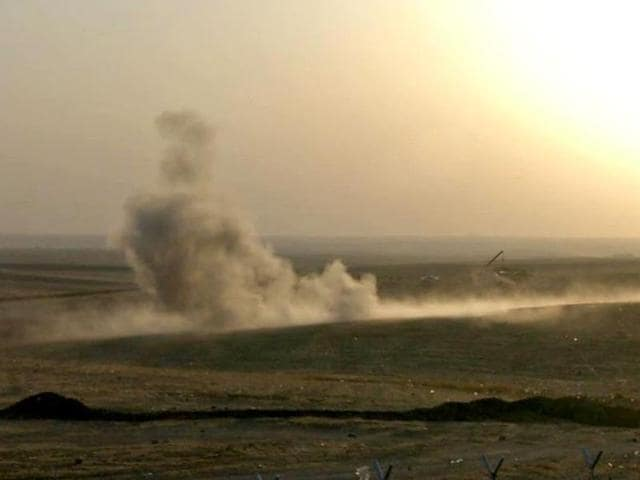 Smoke rising from airstrikes targeting Islamic State militants near the Khazer checkpoint outside Erbil in northern Iraq.