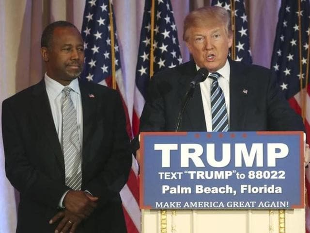 Republican U.S. presidential candidate Donald Trump (R) speaks after receiving the endorsement of former Republican presidential candidate Ben Carson (L) at a campaign event in Palm Beach, Florida March 11, 2016.