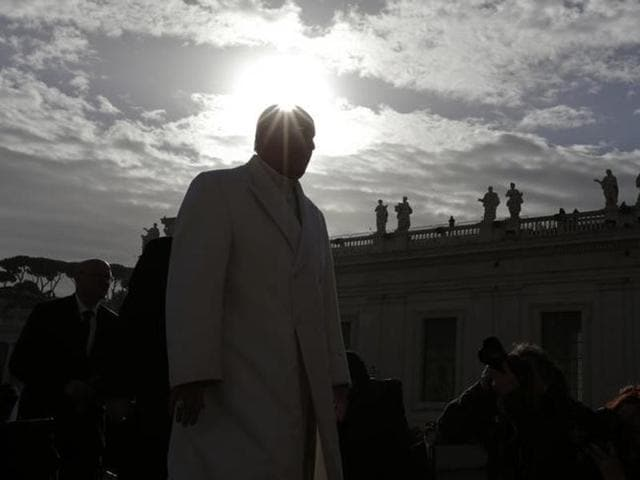 Pope Francis arrives to lead his weekly general audience in Saint Peter's Square at the Vatican.
