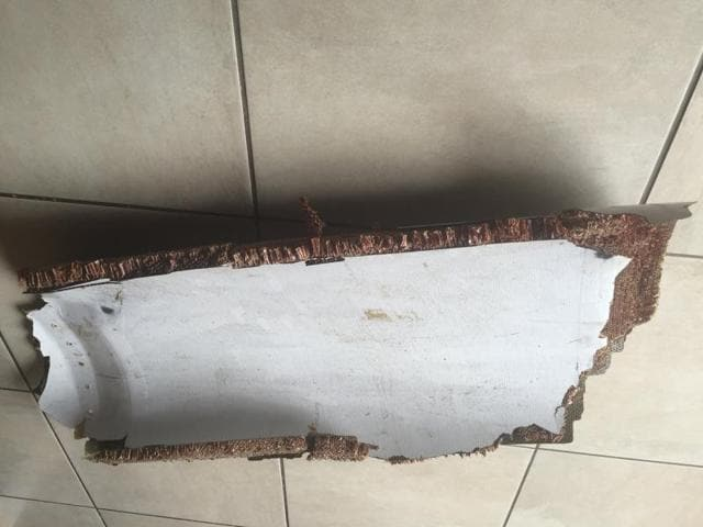 The curved piece of debris which may be part of the missing Malaysia Airlines Flight MH370, in Wartburgnear Pietermaritzburg, South Africa.
