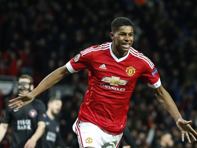 United's Marcus Rashford celebrates after scoring during the Europa League round of 32 second leg soccer match between Manchester United and FC Midtjylland in Manchester, England.